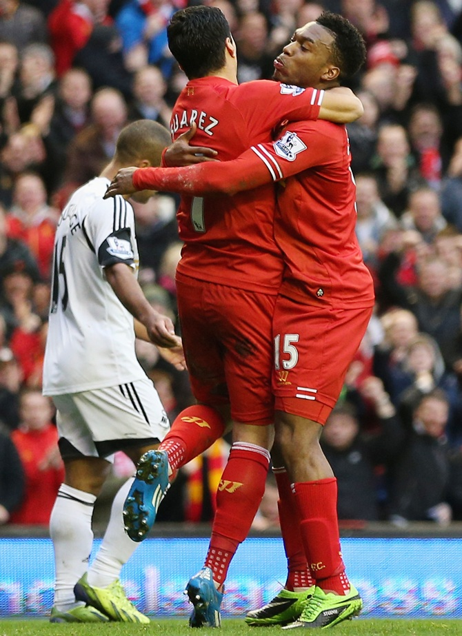 Daniel Sturridge, left, of Liverpool celebrates scoring his team's third goal with Luis Suarez.