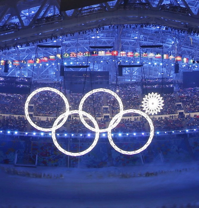 Four of five Olympic Rings are seen lit up during the opening ceremony of the 2014 Sochi Winter Olympics.