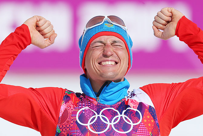 Gold medalist Alexander Legkov of Russia celebrates during the flower ceremony for the Men's 50 km Mass Start Free event at Laura Cross-country Ski & Biathlon Center in Sochi on Sunday