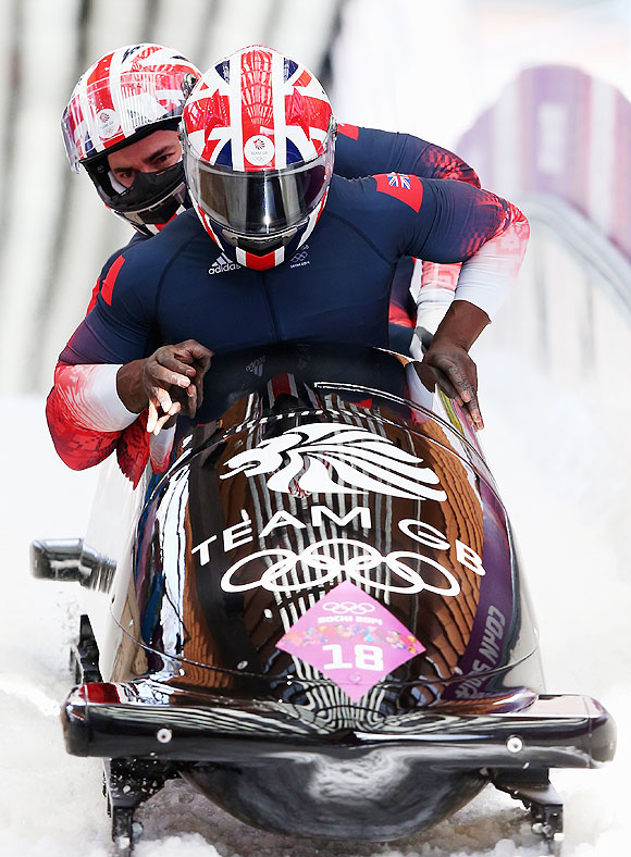 Pilot Lamin Deen, John Baines, Andrew Matthews and Ben Simons of Great Britain team 2 finish a run during the Men's Four-Man Bobsleigh at Sliding Center Sanki in Sochi on Sunday