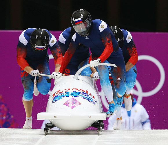 Pilot Alexander Zubkov, Alexey Negodaylo, Dmitry Trunenkov and Alexey Voevoda of Russia team 1 make a run during the Men's Four Man Bobsleigh heats on Saturday