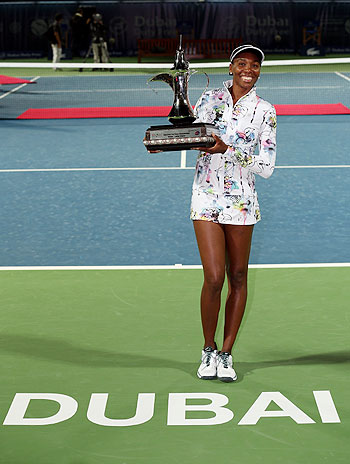 Venus Williams of the USA poses with the trophy after beating Alize Cornet of France in the final of the WTA Dubai Duty Free Tennis Championship at the Dubai Tennis Stadium on Saturday