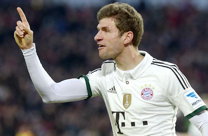 Bayern Munich's Thomas Mueller celebrates after scoring during the German Bundesliga match against Hanover 96 in Hanover on Sunday