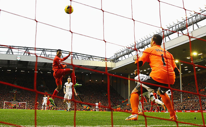 Daniel Sturridge of Liverpool scores his team's third goal during the Barclays Premier League match against Swansea City at Anfield in Liverpool on Sunday