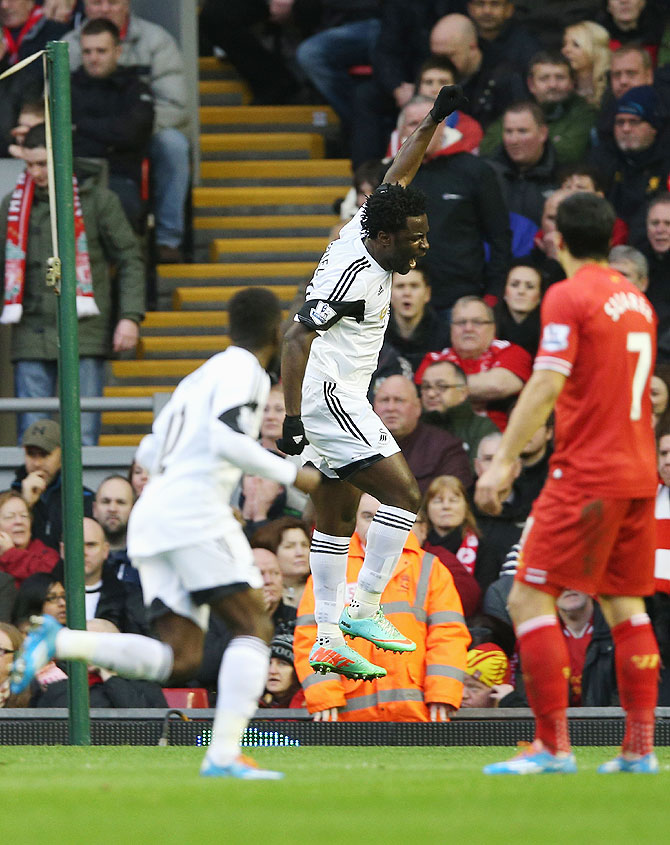 Wilfried Bony of Swansea City celebrates scoring his team's second goal during their match against Liverpool on Sunday