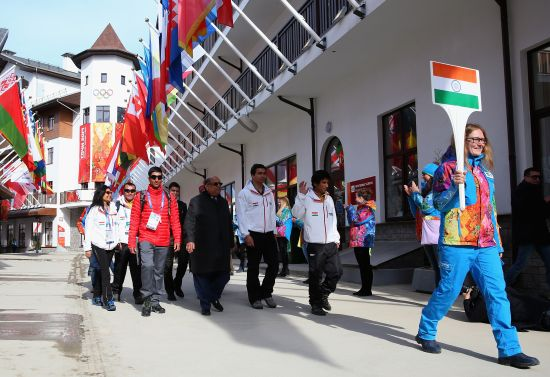 Indian athletes Nadeem Iqbal , Shiva Keshavan and Himanshu Thakur with newly elected IOA President, Narayna Ramachandran arrive during the welcome ceremony and flag raising at the mountain athletes village.