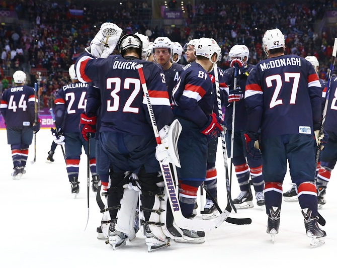 The United States players react after losing to Finland.