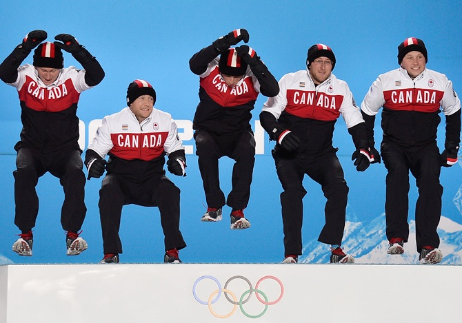(From left) Gold medalists Brad Jacobs, Ryan Fry, EJ Harnden, Ryan Harnden and Caleb Flaxey of Canada celebrate during the medal ceremony for Men's Cur