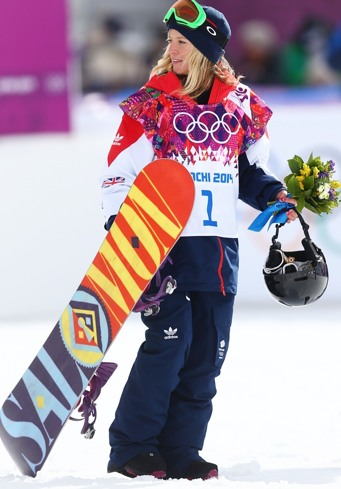 Bronze medalist Jenny Jones of Great Britain celebrates during the flower ceremony for the Women's Snowboard Slopestyle Finals.