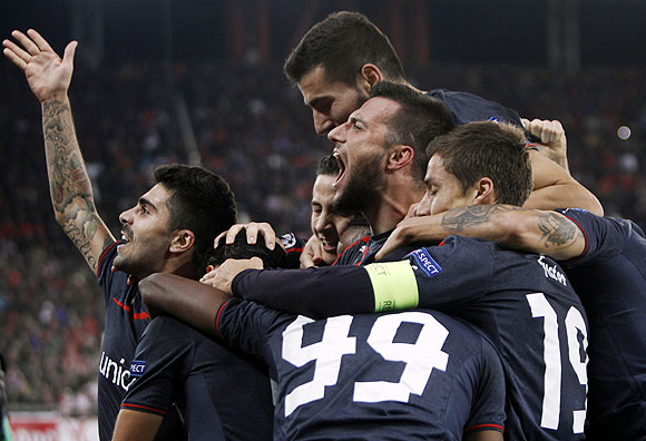 Olympiakos Piraeus players celebrate