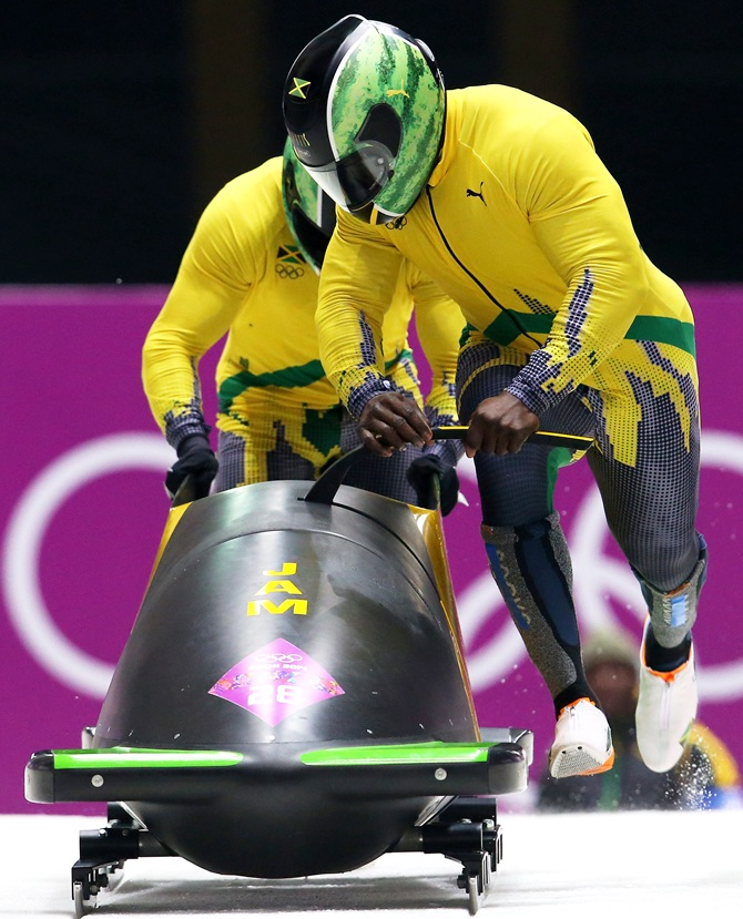 Pilot Winston Watts and Marvin Dixon of Jamaica team 1 make a run during the Men's Two-Man Bobsleigh heats.