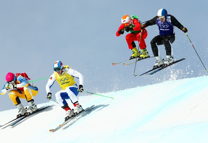 Victor Oehling Norberg of Sweden (red bib), Egor Korotkov of Russia (yellow bib), Armin Niederer of Switzerland (green bib) and Jouni Pellinen of Finland (blue bib) compete during the Freestyle Skiing Men's Ski Cross 1/8 Finals.