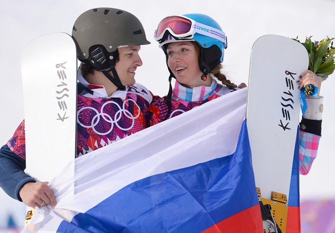Men's gold medalist Vic Wild of Russia and women's bronze medalist Alena Zavarzina of Russia celebrate.