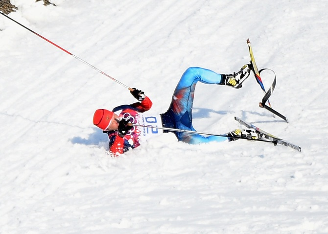 Anton Gafarov of Russia collapses in the Finals of the Men's Sprint Free.