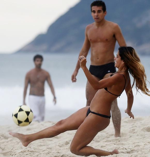 Brazilian fans play football.