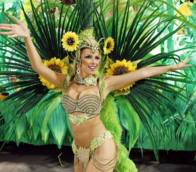 A reveller from the Vila Isabel samba school participates in the annual Carnival parade in Rio de Janeiro.