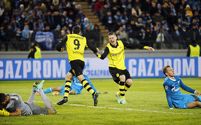 Borussia Dortmund's Robert Lewandowski and Lukasz Piszczek (2nd from right) celebrate a goal against Zenit St Petersburg during their Champions League round of 16 first leg match at the Petrovsky stadium in St. Petersburg on Tuesday
