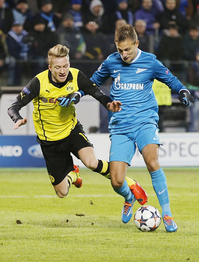 Zenit St Petersburg's Domenico Criscito (right) and Borussia Dortmund's Marco Reus vie for possession during their Champions League match on Tuesday