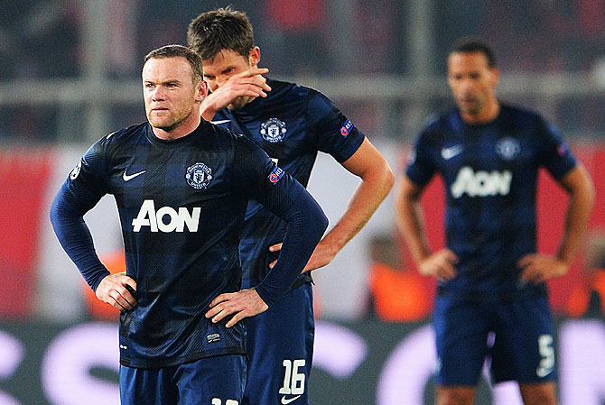 Wayne Rooney and Michael Carrick of Manchester United react after conceding their second goal against Olympiacos FC during the UEFA Champions League Round of 16 first leg match at Karaiskakis Stadium on Tuesday