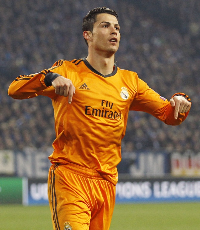Real Madrid's Cristiano Ronaldo celebrates a goal against Schalke 04.