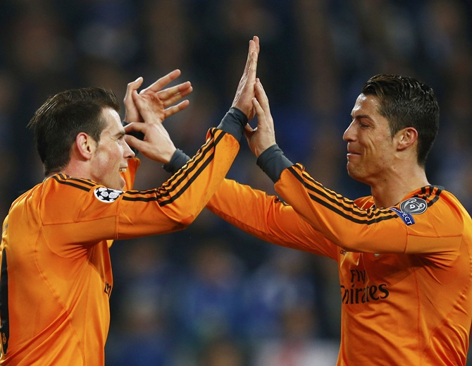 Real Madrid's Gareth Bale, left, and Cristiano Ronaldo celebrate Bale's goal against Schalke 04.