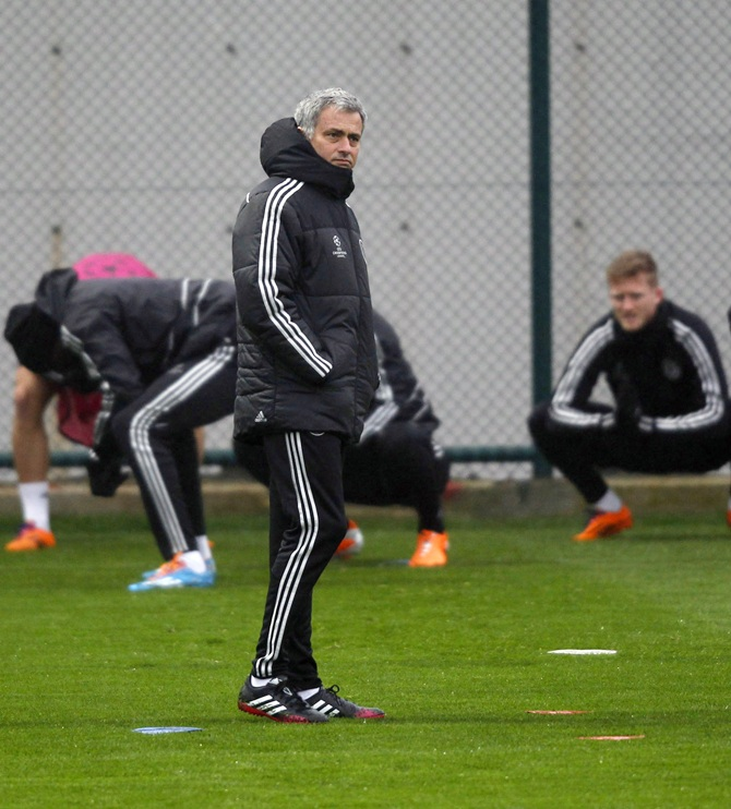 Chelsea manager Jose Mourinho, centre, attends a training session.