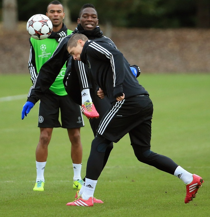 Fernando Torress gets clipped by Kenneth Omeruo as he goes to head the ball during the Chelsea FC training session.