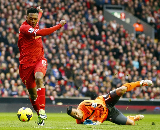 Liverpool's Daniel Sturridge, left, scores past Swansea's Michel Vorm during their English Premier League match at Anfield.