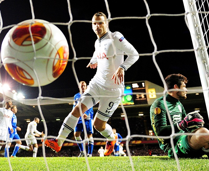 Roberto Soldado of Tottenham Hotspur watches the ball hit the back of the net after Christian Eriksen of Tottenham Hotspur (not pictured) scores the first goal.