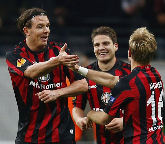 Eintracht Frankfurt's Alexander Meier,left, and Stefan Aigner celebrate Meier's goal against Porto.