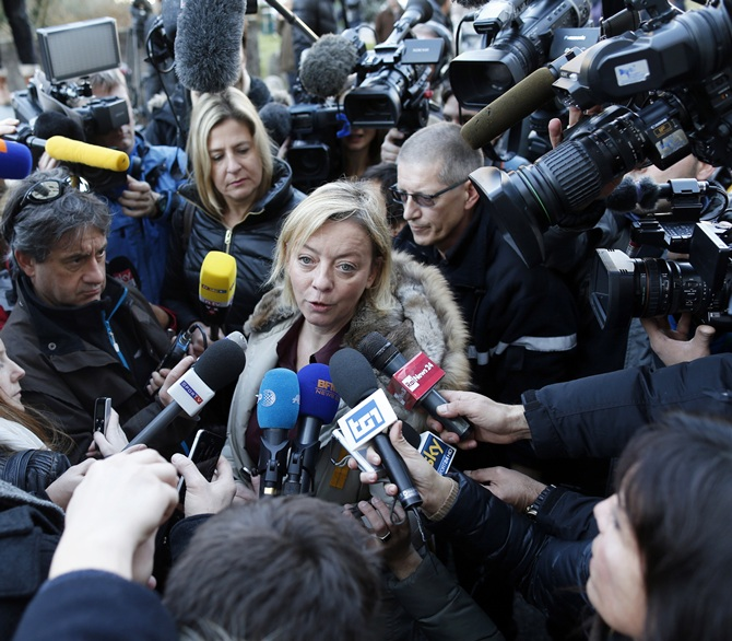 Sabine Kehm (centre), agent for Michael Schumacher, talks to journalists