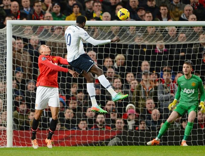 Emmanuel Adebayor of Tottenham Hotspur scores the opening goal