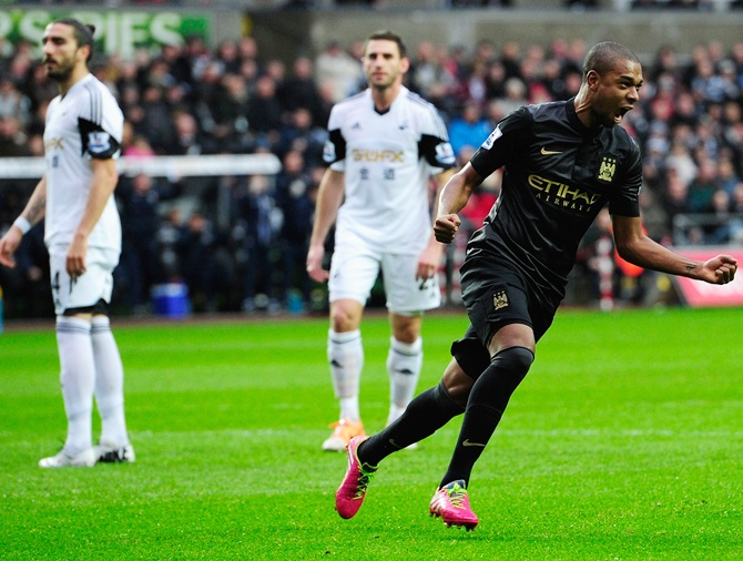 Manchester City player Fernandinho (right) celebrates