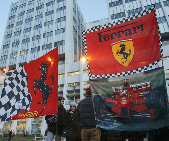 Ferrari flags are seen in front of the CHU Nord hospital emergency unit in Grenoble, French   Alps, where Michael Schumacher is hospitalized after a ski accident