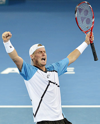 Lleyton Hewitt of Australia celebrates after defeating Roger Federer of Switzerland in the final of the Brisbane International at Queensland Tennis Centre on Sunday