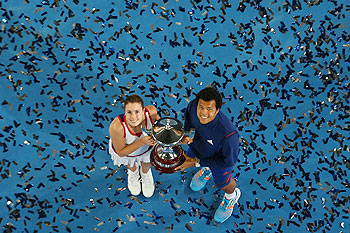 Alize Cornet and Jo-Wilfried Tsonga of France pose with the Hopman Cup trophy after defeating Agnieszka Radwanska and Grzegorz Panfil of Poland in the final on day eight of the Hopman Cup at Perth Arena on Saturday