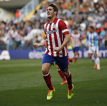 Atletico Madrid's Koke celebrates after scoring a goal against Malaga during their Spanish First Division soccer match at La Rosaleda stadium in Malaga on Saturday