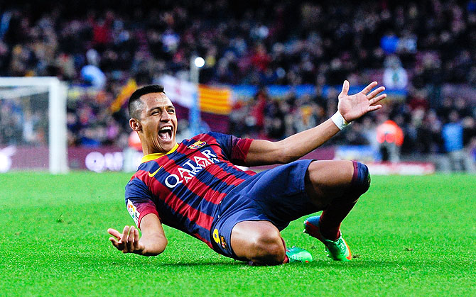 Alexis Sanchez of FC Barcelona celebrates after scoring his team's fourth goal to complete his hat-trick agaisnt Elche FC during their La Liga match at Camp Nou in Barcelona on Sunday