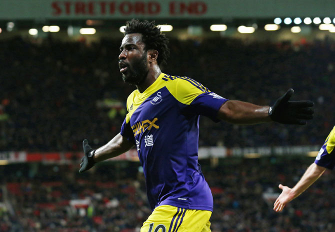 Wilfried Bony of Swansea City celebrates scoring his team's second goal during the FA Cup against Manchester United at Old Trafford on Sunday