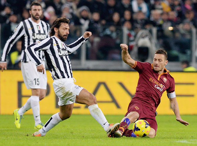 Andrea Pirlo (left) of FC Juventus and Francesco Totti of AS Roma vie for possession during the Serie A match at Juventus Arena in Turin on Sunday