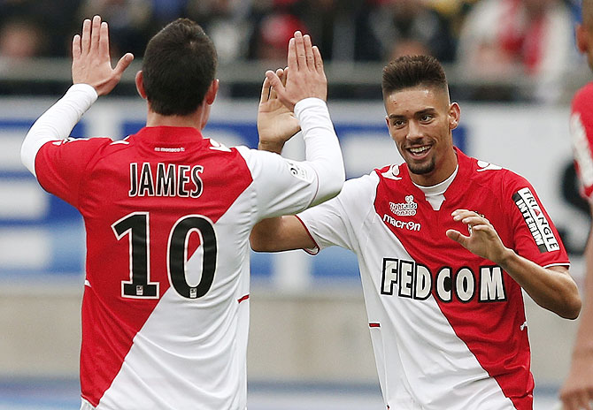 AS Monaco's Yannick Ferreira Carrasco is congratulated by his team-mate James Rodriguez (left) after scoring