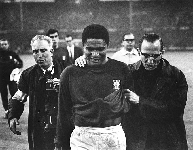 Eusebio leaves the pitch in tears after England beat Portugal 2-1 in the 1966 World Cup sem-finals at Wembley Stadium