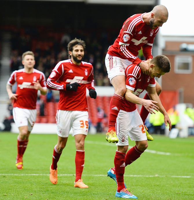 Jamie Paterson of Nottingham Forest celebrates scoring his third goal with Henri Lansbury