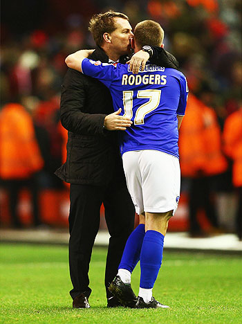 Liverpool manager Brendan Rodgers (left) kisses son Anton Rodgers of Oldham Athletic after their FA Cup third round match at Anfield on Sunday