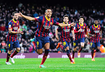 Alexis Sanchez of FC Barcelona celebrates after scoring his team's fourth goal against Elche FC during the La Liga match at Camp Nou on Sunday