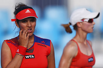 Cara Black of Zimbabwe and Sania Mirza of India look on during their match against Jarmila Gajdosova of Slovakia and Ajla Tomljanovic of Croatia on Day 2 of the Sydney International at Sydney Olympic Park Tennis Centre on Monday
