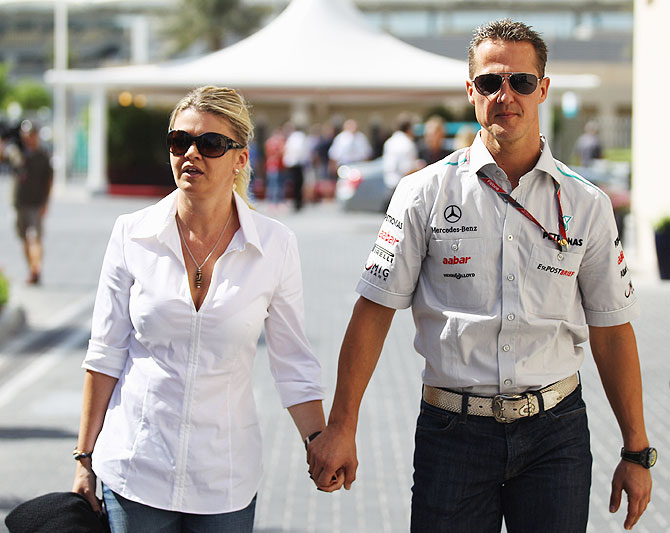 Michael Schumacher of Germany and Mercedes GP walks with his wife Corrina