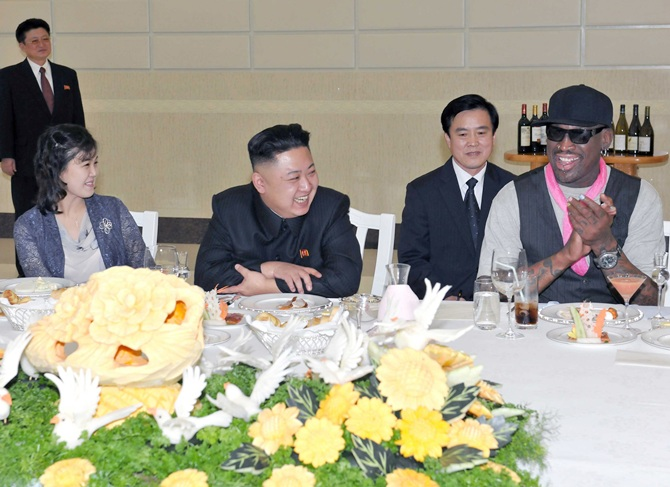 Kim Jong-Un, his wife Ri Sol-Ju and former NBA basketball player Dennis Rodman talk in Pyongyang