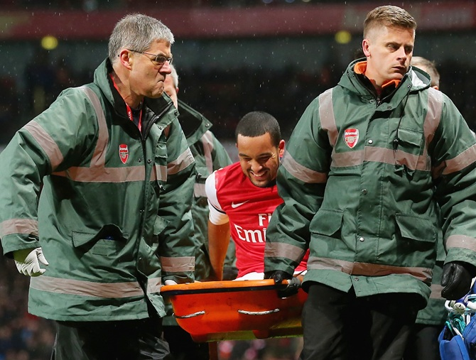 Theo Walcott of Arsenal is stretchered off the pitch during the FA Cup third round match against Tottenham Hotspur