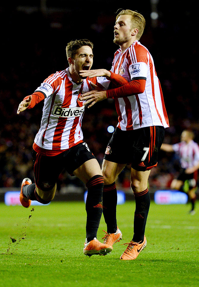 Fabio Borini of Sunderland (left) celebrates with Sebastian Larsson (right) as he scores their second goal from the penalty spot during the League Cup semi-final, first leg match against Manchester United